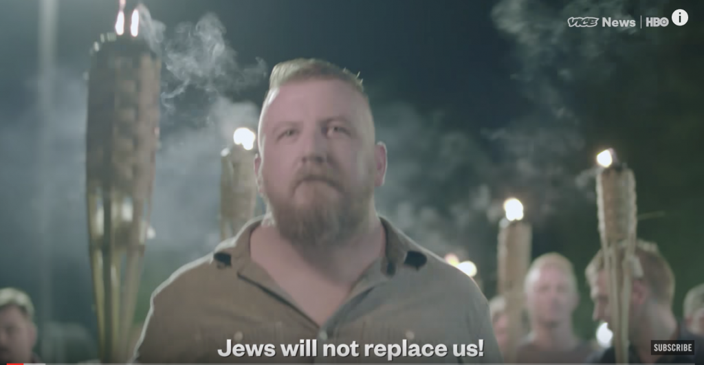 "Still image from the torchlit march the night before the ""Unite the Right"" rally"